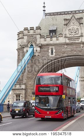 LONDON UNITED KINGDOM - JUNE 22 2017: Tower Bridge on the River Thames and red double-decker bus. The bridge is a symbol of the city and a great attraction for tourists