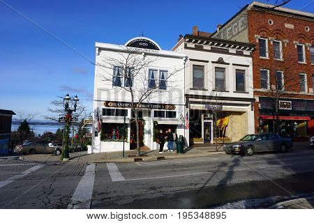 PETOSKEY, MICHIGAN / UNITED STATES - NOVEMBER 22, 2016: One may purchase gifts at Grandpa Shorter's Gift Shop, and shoes at Robert Frost Fine Footwear, on Lake Street in downtown Petoskey.