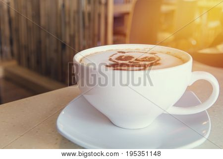 Latte Art Coffee Or Cappuccino On Wooden Table Background
