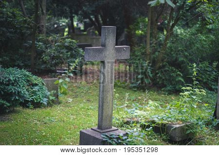 Gravestone On / Cemetery - Stone Cross On Grave
