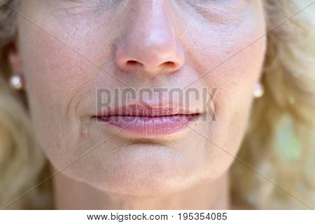 Lower Face Of A Senior Lady With A Quiet Smile