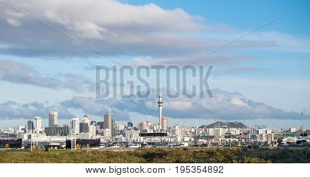 Traffic on Northern motorway SH1 with Auckland skyline in background New Zealand NZ - copy space in sky