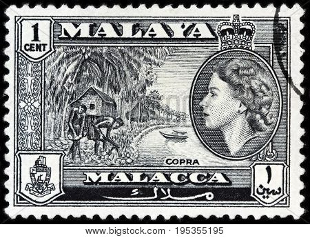 LUGA RUSSIA - APRIL 26 2017: A stamp printed by MALAYA shows image portrait of Queen Elizabeth II against beautiful landscape of peninsula in Southeast Asia circa 1957.