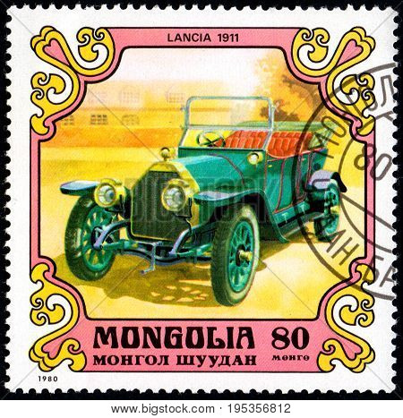 UKRAINE - CIRCA 2017: A postage stamp printed in Mongolia shows motorcar Lancia Italy 1911 from the series Antique Cars circa 1980
