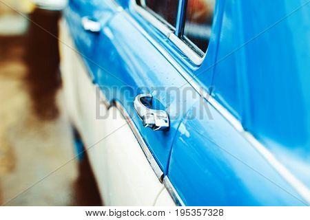 The blue door of an old Soviet car