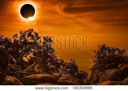 Amazing scientific natural phenomenon. Total solar eclipse glowing on sky and cloudy above view point on the top of mountain serenity nature in forest. Abstract fantastic background.