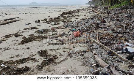 coastal rubbish and trash washed onto Australian beach