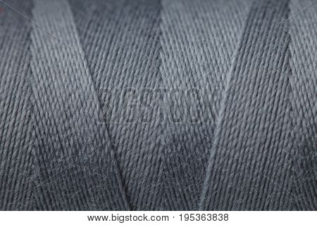 Spool Of Thread And Needle Isolated On A White Background