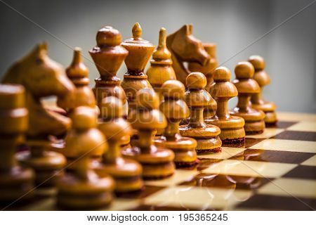 Set of white chess pieces on the board close up.