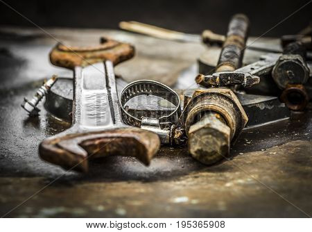 Old rusty parts and tools for repair of machinery.