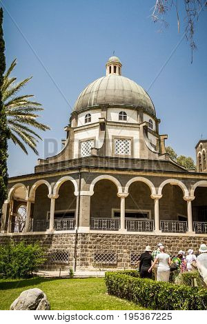 SEA OF GALILEE ISRAEL - MAY 15: Church of Mount of Beatitudes with marble colonnade near Sea of Galilee in Israel on May 15 2017
