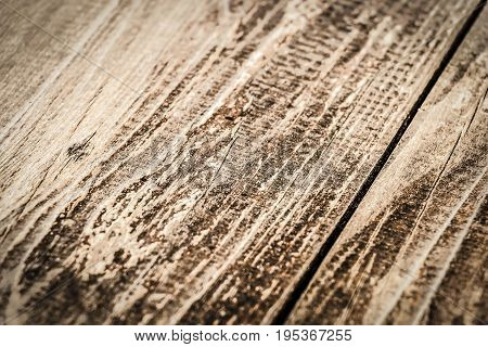 Brown on the veranda floorboards close up as background.