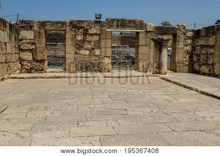 Archaeological site Capernaum ancient ruins of synagogue of white calcareous stone on the shore of the Sea of Galilee in Israel