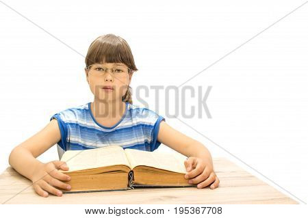Cute teenager with book on white background serious face