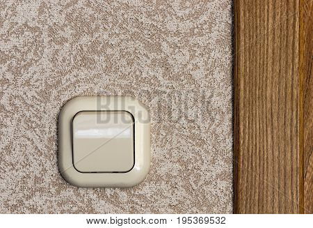 Home beige plastic light switch home closeup.