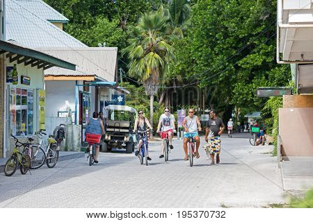 La Digue, Seychelles  - May 08, 2016:  The main central street on the island of La Digue (near the La Passe village centre). Bicycles - A typical means of transportation for tourists and locals.