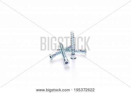 Photo of screws on empty white background