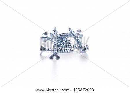 Photography of few screws isolated on blank white background