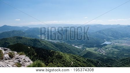 spectacular panorama from Chleb hill in Krivanska Mala Fatra mountain range in Slovakia with mountains and Vah river valley with villages