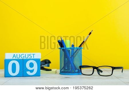 August 9th. Image of august 9, calendar on yellow background with office supplies. Summer time.