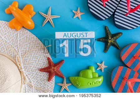 August 15th. Image of August 15 calendar with summer beach accessories and traveler outfit on background. Summer day, Vacation concept.