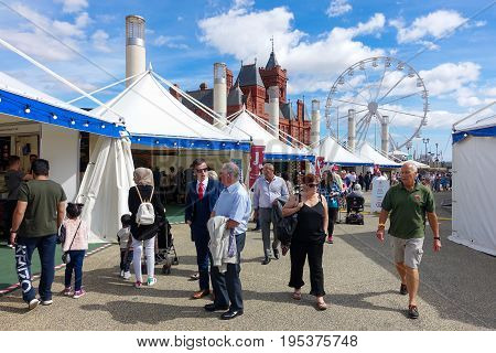 Cardiff United Kingdom - July 14 2017: People are visiting the Food Stalls on the opening day of the Cardiff International Food Festival 2017 at Roald Dahl Plass Cardiff Bay Cardiff Wales UK.