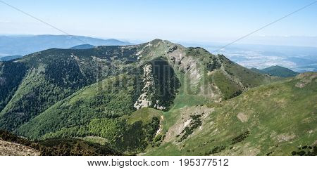 view to Maly Krivan hill from highest hill of Mala Fatra mountains - Velky Krivan during nice spring day with clear sky