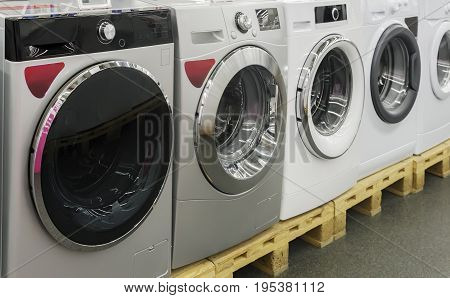 Appliances store presents for sale a modern washing machine.