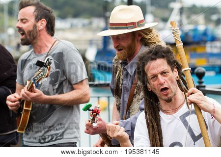PADSTOW, CORNWALL, UK - APRIL 16, 2017. Members of the politically motivated busking group 'Phat Bollard' whose election video went viral. playing on the harbour at Padstow in Cornwall, UK.