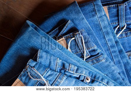 blue pant jeans on brown wood background