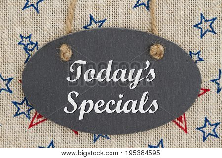 Today's Specials text on a chalkboard with red and blue stars on burlap