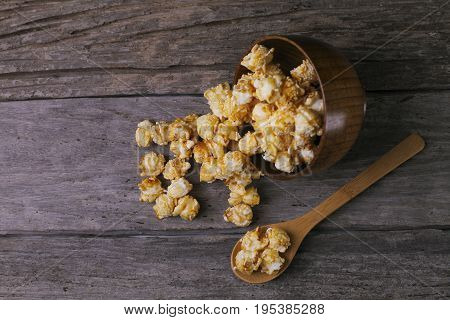 Caramel Popcorn In The Bowl Wooden Background.