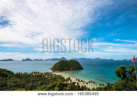 EL NIDO PALAWAN PHILIPPINES - JANUARY 18 2017: Sunny day with many clouds at Las Cabanas Beach with the zipline that brings to the beach.