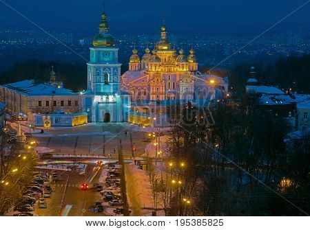 Saint Michael's Square top view at night (Kiev Ukraine). Winter season so streets and buildings are powdered with snow.