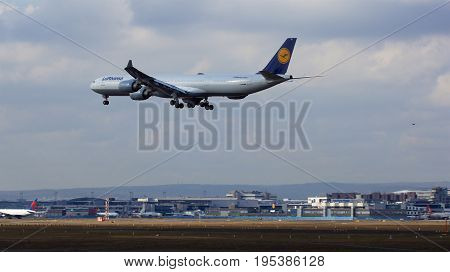 FRANKFURT, GERMANY - FEB 28th, 2015: Lufthansa Airbus A340-600 of Lufthansa airline landing at Frankfurt International Airport FRA. The Airbus A340 - MSN 569 - registration D-AIHI is named City Moenchengladbach.