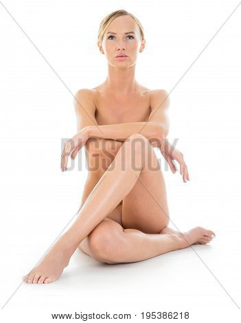 Naked slim woman with perfect female body isolated on white. Studio photography front view