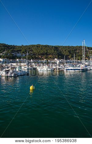 Vertical view of Boats and marina in L'Estartit city on the Costa Brava under blue sky