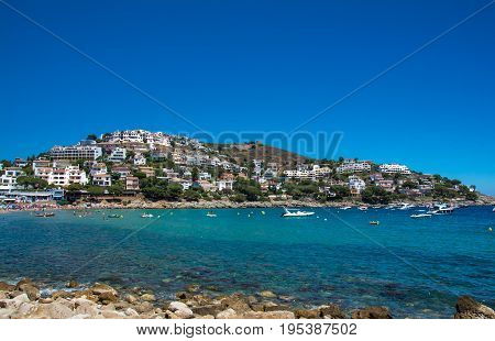 Horizontal view of Montgo beach and hills on the Costa Brava in summertime