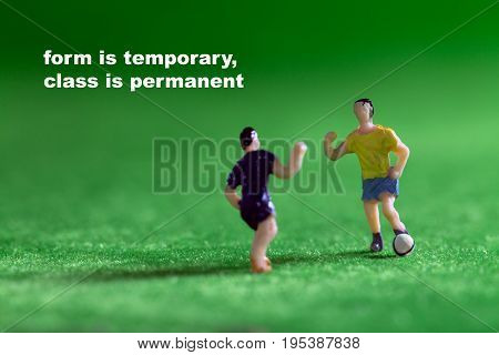 Football players or soccer players on grass field