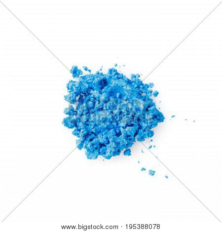 Crushed blue eye shadow isolated on the white background