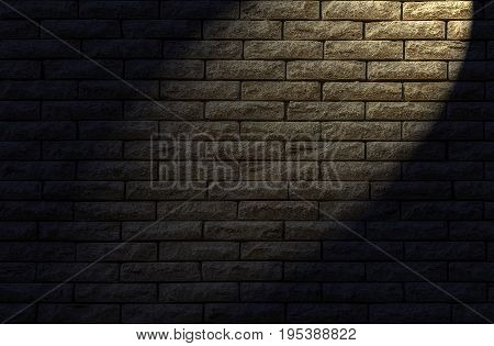 Wall made of decorative yellow brick as a background. The backlight lamp in the evening.