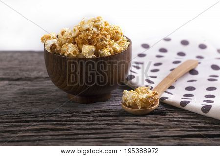 Caramel Popcorn In The Bowl Wooden White Background