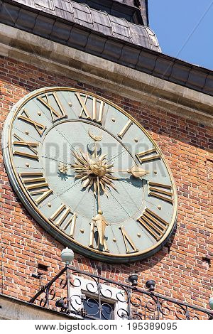 Old clock on the former city hall in Krakow (Poland)