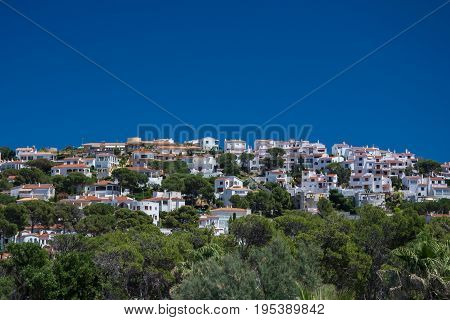 White houses and pines on Montgo hill on the Costa Brava