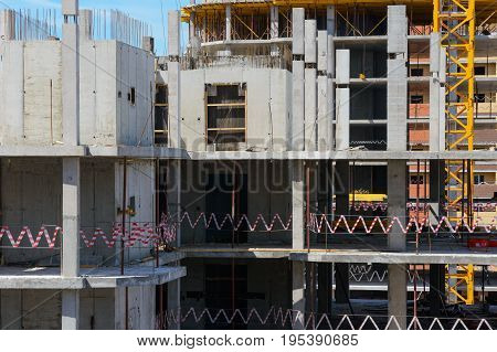 The frame of a multifamily high-rise residential building during construction