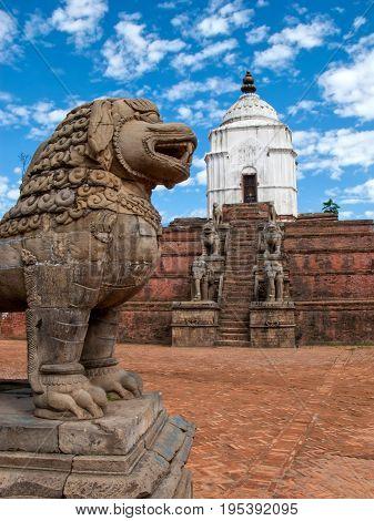 KATHMANDU, BHAKTAPUR, NEPAL. 30 September 2008: Ancient stone lions and  stone Siddhi Lakshmi Temple in the Durbar square in Bhaktapur.
