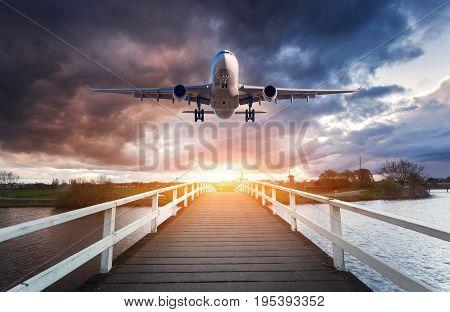 Airplane And Wooden Bridge