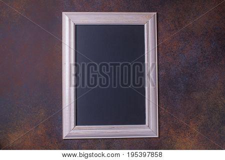 Black Chalk Board On A Brown Background, Copyspace, Horizontal