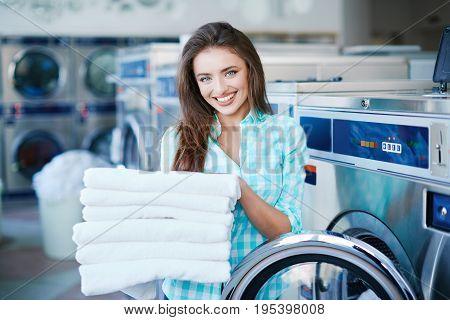 Girl With A Heap Of Linen