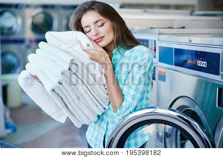 Young Woman With A Heap Of Linen